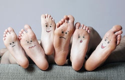 Human soles with painted faces. Close-up. Concept of feet care Royalty Free Stock Photo