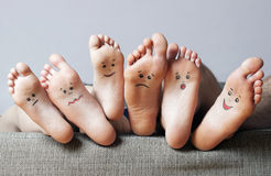 Human soles with painted faces Royalty Free Stock Photos