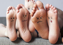 Human soles with painted faces. Close-up. Concept of feet care Royalty Free Stock Photos