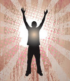 Human Soul. Young man reaching for the sky in celebration, seen in silhouette, glowing from within Royalty Free Stock Images