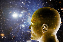 Human and space. Universe background with a human head looking forward and in the future Royalty Free Stock Photography
