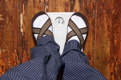 Human standing on scales Royalty Free Stock Photography