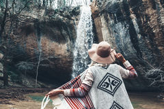 Human standing by the waterfall Stock Photography