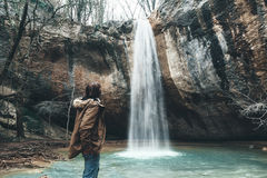 Human standing by the waterfall Royalty Free Stock Photo