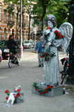 Human statue dressed as angel Royalty Free Stock Photo