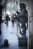 Human statue in Gran via observed by the wayfarers, Granada, An Stock Photos