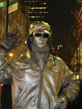 Human Statue: Man Painted Silver NYC stock photo