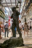 Human statue of a miner. Malaga, Spain - August 03, 2018. Human statue of a miner performs on the Marques de Larios pedestrian, in the historic center of Malaga stock images