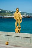 Human statue on the sea-front Royalty Free Stock Images