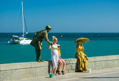 Human statues (live artists) on the sea-front earn money Stock Images