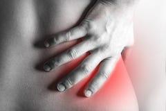 Human suffering from backache. stock photos