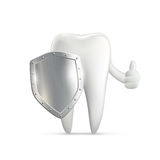 Human tooth holding metal shield Royalty Free Stock Images