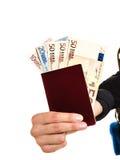 Human tourist holding money and passport. Royalty Free Stock Photos
