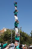 Human tower. Castellers of Sagrada Familia performing a human tower in the festival of La Sagrada Familia on April 21, 2013 in Barcelona, Spain Stock Photos