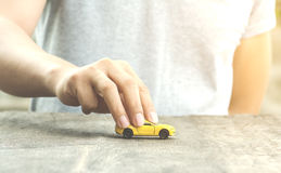 Human with toy car Royalty Free Stock Photography