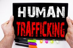 Human Trafficking text written on tablet, computer in the office with marker, pen, stationery. Business concept for Slavery Crime Stock Photo