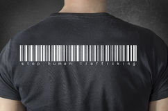 Human trafficking tittle and barcode on black t-shirt. Back. Stop human trafficking tittle and barcode on black t-shirt. Back view Stock Photo