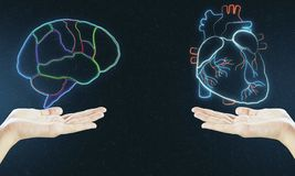 Human verses Artificial Intelligence concept with digital brain and heart hologram layouts above hands