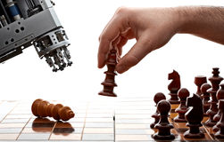 Human versus machine. Human playing chess with a machine Royalty Free Stock Images