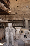 Human victim body cast and ancient amphora, Pompeii, Italy Stock Photos