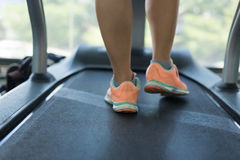 Human walking exercise on run treadmill machine cardio equipment Royalty Free Stock Image