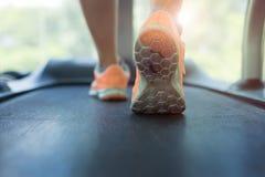 Human walking exercise on run treadmill machine cardio equipment Royalty Free Stock Images