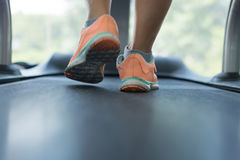 Human walking exercise on run treadmill machine cardio equipment. Close-up footwear image, human jogging exercise on run treadmill machine cardio equipment at Stock Photo