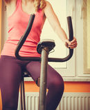 Human working out on exercise bike. Fitness. Royalty Free Stock Photography