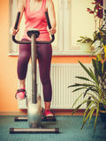 Human working out on exercise bike. Fitness. Stock Image