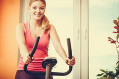 Human working out on exercise bike. Fitness. Stock Photo