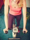 Human working out on exercise bike. Fitness. Royalty Free Stock Photo