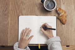 Human Writing on Notebook Royalty Free Stock Images