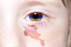 Human& x27; 与亚美尼亚的国旗和地图的s面孔 免版税库存图片