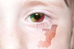 Human& x27; 与刚果共和国的国旗和地图的s面孔 库存图片
