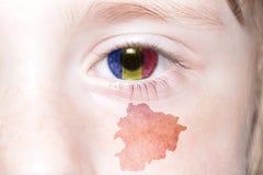 Human& x27; 与安道尔的国旗和地图的s面孔 免版税库存照片