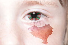 Human& x27; 与巴斯克国家国旗和地图的s面孔  免版税库存照片