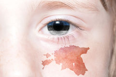 Human& x27;s face with national flag and map of estonia . Stock Photo