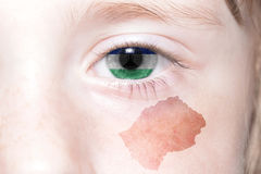 Human& x27;s face with national flag and map of lesotho. Royalty Free Stock Photos