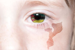 Human& x27;s face with national flag and map of mozambique. Stock Photos