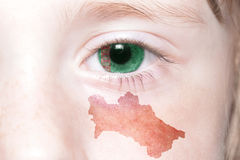 Human& x27;s face with national flag and map of turkmenistan. Stock Image