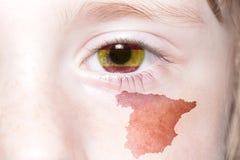 Human& x27 ; visage de s avec le drapeau national et la carte de l'Espagne Photographie stock libre de droits