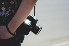 Human's Carying Black Canon Dslr Camera during Day Time Stock Image