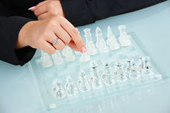 Humand hands playing chess Royalty Free Stock Photography