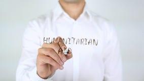 Humanitaire Hulp, Zakenman Writing op Glas stock afbeeldingen