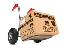 Humanitarian Aid - Cardboard Box on Hand Truck. Humanitarian Aid Slogan on Cardboard Box on Hand Truck White Background Stock Photo