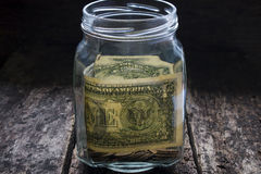 Humanitarian aid money in the bank on a wooden Royalty Free Stock Images