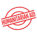 Humanitarian Aid rubber stamp. Grunge design with dust scratches. Effects can be easily removed for a clean, crisp look. Color is easily changed Royalty Free Stock Photos