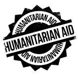 Humanitarian Aid rubber stamp. Grunge design with dust scratches. Effects can be easily removed for a clean, crisp look. Color is easily changed Stock Photography