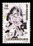 Humanitarian aid, serie, circa 2001. MOSCOW, RUSSIA - AUGUST 18, 2018: A stamp printed in Luxembourg shows Humanitarian aid, serie, circa 2001 stock photos