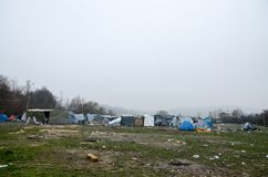 A humanitarian catastrophe in Refugee And Migrants Camp In Bosnia And Herzegovina. The European migrant crisis. Balkan Route. Tent royalty free stock photography